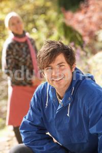Portrait Of Romantic Young Couple In Autumn Park